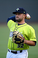 Catcher Phil Capra (32) of the Columbia Fireflies warms up before a game against the Hickory Crawdads on Tuesday, August 27, 2019, at Segra Park in Columbia, South Carolina. Columbia won, 3-2. (Tom Priddy/Four Seam Images)