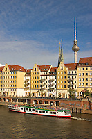 Germany, Berlin.  Nikolai-viertel.  Water front onto the River Spree with tourist boats.