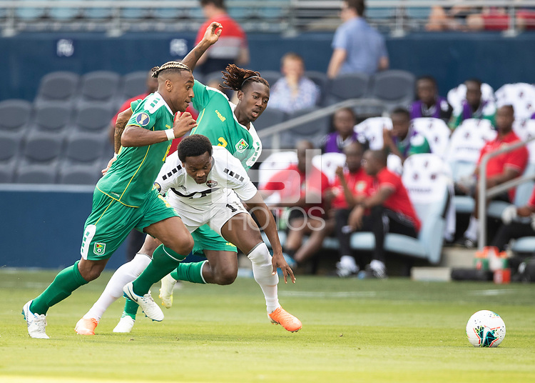 KANSAS CITY, KS - JUNE 26: Daniel Kadell #3 and Neil Danns #16 defend against Levi Garcia #11 during a game between Guyana and Trinidad
