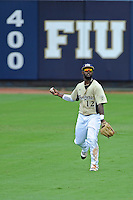 4 March 2012:  FIU outfielder Pablo Bermudez (12) throws the ball back to the infield as the FIU Golden Panthers defeated the Brown University Bears, 8-3, at University Park Stadium in Miami, Florida.