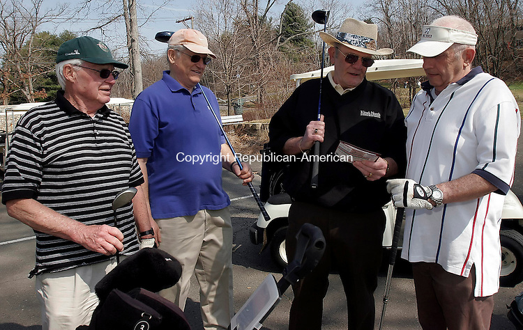 NAUGATUCK, CT-31 March 2006-033106TK03- (left to right:) Francis Patt, Peter Pearce,   along with Joe Conrow and Dick Pierce compare score card score befor teeing off at the sixth tee at Hop Brook Golf Course in Naugatuck Friday morning. Spring temperatures and a warm sun welcomed golfers on the opening of Hop Brook Golf Course in Naugatuck for the season.   Tom Kabelka Republican-American (Peter Pearce, Dick Pier, Joe Conroy, Francis Patt)