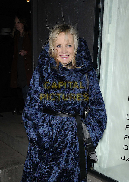 "Twiggy Lawson.attended the ""Bill Wyman : Reworked"" private view, Rook & Raven, Rathbone Place, London, England..February 26th, 2013.half length blue black coat belted hands in pockets fur pattern.CAP/CAN.©Can Nguyen/Capital Pictures."
