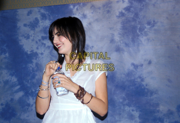 CAMILLA BELLE.March 2005.half length white top bottled water bracelets.www.capitalpictures.com.sales@capitalpictures.com.© Capital Pictures.