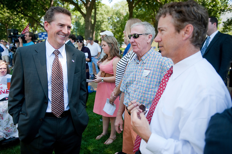 "UNITED STATES - JULY 27: Sen. Jim DeMint, R-S.C., left, speaks with Sen. Rand Paul, R-Ky., during the American Grassroots Coalition and Tea Party Express rally to encourage Republicans to ""Hold the Line"" in the debt negotiations and to support the ""Cut, Cap & Balance"" plan on Wednesday, July 27, 2011. (Photo By Bill Clark/Roll Call)"