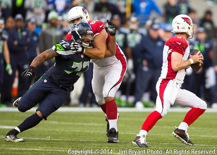 Seattle Seahawks defensive end Michael Bennett (72) is block by Arizona Cardinals tackle Jared Veldheer (68) while pass rushing Cardinals quarterback Drew Stanton (5) at CenturyLink Field in Seattle, Washington on November 23, 2014. The Seahawks beat the Cardinals 19-3.   ©2014. Jim Bryant Photo. All Rights Reserved.