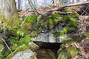 Granite culvert along the old Boston and Maine Railroad in the area of the now gone Zealand Village in Carroll, New Hampshire USA. Zealand Village, built by J.E. Henry was part of the Zealand Valley Railroad.
