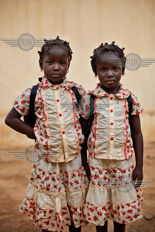 A portrait of two girls at a school in Bambougou.