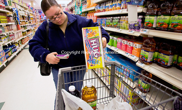 WATERTOWN, CT - 12 FEBRUARY 2009 -021209JT07-<br /> Lizza Burke, of Oakville, uses a Scan It scan gun on a package of fruit drinks as she shops at the Watertown Super Stop &amp; Shop on Thursday. This is the first time Burke has used Scan It, saying, &quot;My husband's going to love this. He thinks I spend too much time here anyway.&quot;<br /> Josalee Thrift / Republican-American