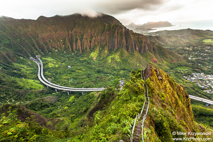 "An aerial view of the Ko'olau mountain range & H-3 freeway in Haiku valley at dawn from Haiku Stairs (""Stairway to Heaven"") hiking trail in Kaneohe, Oahu"