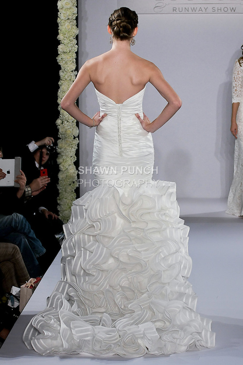 Model walks runway in a Hayden wedding dress from the Maggie Sottero Spring 2013 Bridal collection, for the Couture Runway Show, during New York Bridal Fashion Week at The Hilton Hotel, October 13, 2012.