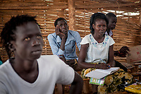 Secondary students attend Gaflauk Jaok's economics class in an emergency school in the UN Protection of Civilians camp for internally displaced people in Juba, South Sudan. More than 24,000 people live in the POC on the United Nations compound.