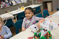 "NWA Democrat-Gazette/CHARLIE KAIJO Samantha Parker, 4, of Rogers looks up at her mother Sheena Parker (not pictured) after completing a craft, Monday, November 4, 2019 during the weekly Storytime Express at the Rogers Public Library in Rogers. <br /> <br /> Storytime Express is a weekly early education program designed to help kids ages 3 to 5 develop the skills needed to succeed in kindergarten. Educators use pictures, songs, stories and crafts exercise to help kids develop cutting and writing skills and practice their letters and the way they sound. Kids also learn how to socialize in a classroom setting. Children learn a new letter every week. This week they learned about the letter ""k"" and created cutout koalas to practice sounding out the letter. ""When they first start out, they don't know how to do a lot of stuff but you see them improve which is neat"" said Dara Stine, assistant children's director."