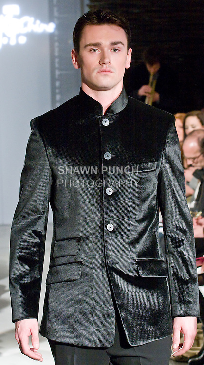 """Model walks the runway in a zhong shan jacket with french flap double pockets, silk shirt, and single pleat pant, during the Blanc de Chine 2010 Fall Winter """"The Elegance of the Ming Design"""" collection runway show on March 24, 2010."""