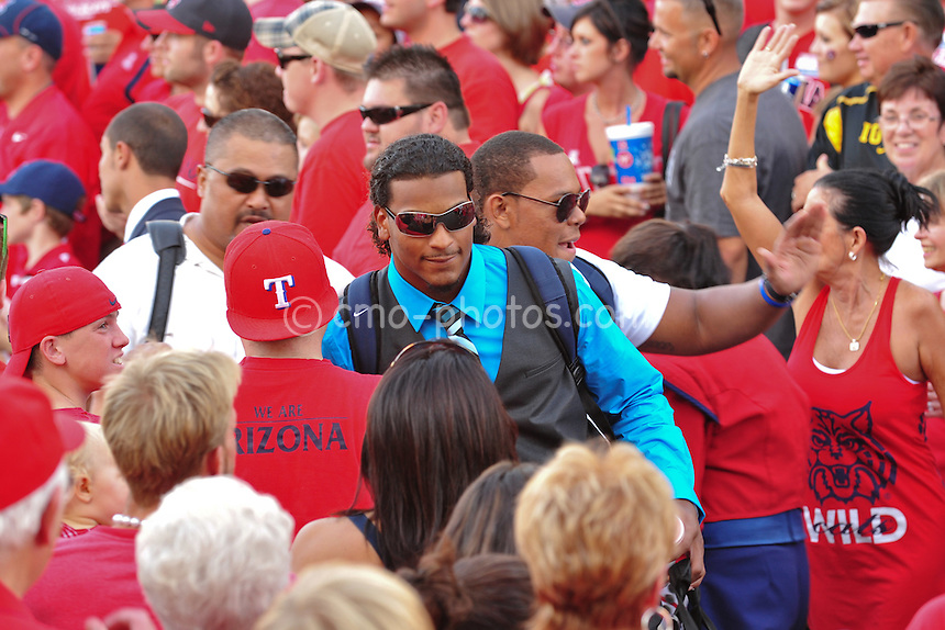 "ept 18, 2010; Tucson, AZ, USA; Arizona Wildcats safety Adam Hall walks through a crowd of fans during ""Wildcat Walk"" prior to a game against the Iowa Hawkeyes at Arizona Stadium."