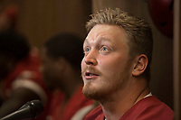 Hawgs Illustrated /BEN GOFF @NWABENGOFF<br /> Hjalte Froholdt, junior offensive lineman from Svendborg, Denmark, talks to the press in the locker room Saturday, Aug. 5, 2017, during Arkansas football media day at the Fred W. Smith Football Center in Fayetteville.