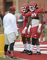 NWA Democrat-Gazette/ANDY SHUPE<br /> Arkansas defensive linemen McTelvin Agim (3) and Armon Watts (90) participate in a drill Tuesday, Aug. 7, 2018, during practice at the university practice fields in Fayetteville. Visit nwadg.com/photos to see more photographs from the practice.