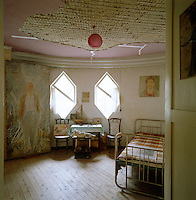 A dilapidated bedroom showing the effect of time and neglect
