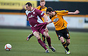 Alloa's Kevin Cawley pulls at the shorts of Arbroath's Alex Keddie.
