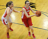 Bridgette Moran #10 of St. John the Baptist, right, passes away from Kaitlyn Stenz #33 of Monsignor McClancy during the CHSAA varsity girls basketball Class B state semifinals at Monsignor McClancy High School in East Elmhurst, NY on Friday, Mar. 11, 2016. McClancy won by a score of 63-49.