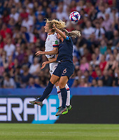 PARIS,  - JUNE 28: Sam Mewis #3 and Amandine Henry #6 head the ball during a game between France and USWNT at Parc des Princes on June 28, 2019 in Paris, France.