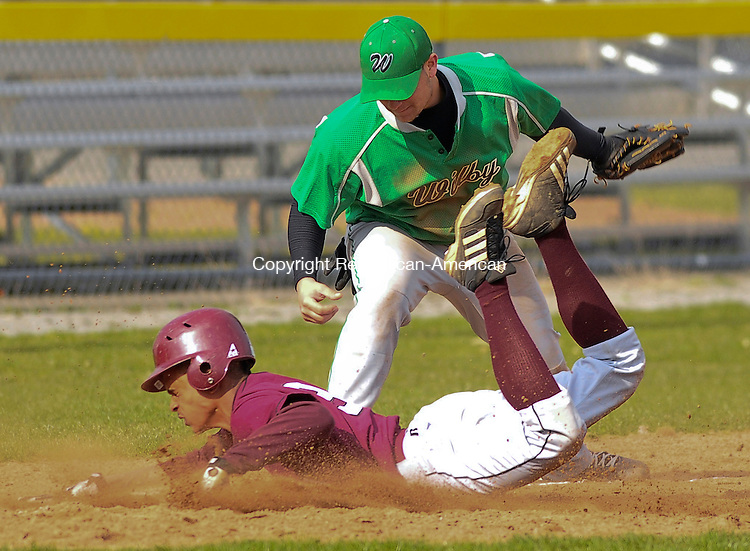 TORRINGTON, CT-08 APRIL 2009-040809JS01-- Torrington's Wellington Sosa slides safely into third on a three-base error as Wilby's Adam Carosella covers the play during their game Wednesday at Fuessenich Park in Torrington<br /> Jim Shannon Republican-American