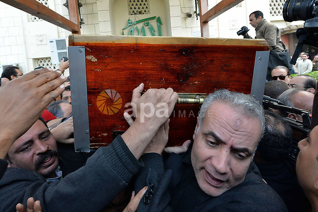 Egyptian mourners carry the coffin of Mamdouh el-Leithi during his funeral in Cairo on January 1, 2014. Prominent producer and scenarist Mamdouh el-Leithi passed away on Wednesday  morning at the age of 77. Photo by Mohammed Bendari