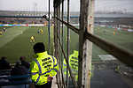 A steward looks on from the main stand at Station Park, Forfar during the SPFL League 2 fixture between Forfar Athletic and Edinburgh City (yellow). It was the club's sixth and final meeting of City's inaugural season since promotion from the Lowland League the previous season. City came from behind to win this match 2-1, watched by a crowd of 446.