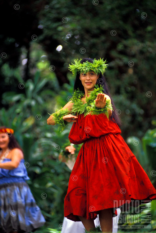 Woman dancing a kahiko (ancient) hula at the Prince Lot hula festival, Island of Oahu