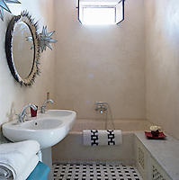 The small bathroom has a double sink and mirror decorated with porcupine spines