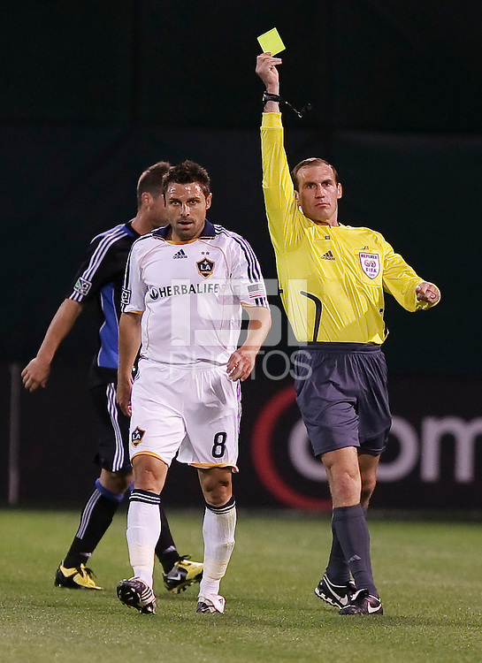 The referee issues a yellow card to Dema Kovalenko. San Jose Earthquakes tied Los Angeles Galaxy 1-1 at the McAfee Colisum in Oakland, California on April 18, 2009.