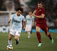 Calcio, Serie A: S.S. Lazio - A.S. Roma, stadio Olimpico, Roma, 15 aprile 2018. <br /> Lazio's Felipe Anderson (l) in action with Edin Dzeko (r) during the Italian Serie A football match between S.S. Lazio and A.S. Roma at Rome's Olympic stadium, Rome on April 15, 2018.<br /> UPDATE IMAGES PRESS/Isabella Bonotto