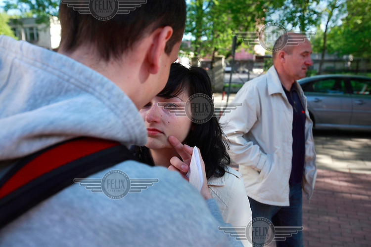 Bartosz Lukasiak says goodbye to his wife Kasia as he leaves for his army base in northern Poland. This year's class of drafted recruits is the final one after 90 years of compulsory military service, as Poland's army turns professional in 2009.