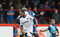 Manny Oyeleke of Aldershot Town & Adebayo Akinfenwa of Wycombe Wanderers during the pre season friendly match between Aldershot Town and Wycombe Wanderers at the EBB Stadium, Aldershot, England on 22 July 2017. Photo by Andy Rowland.
