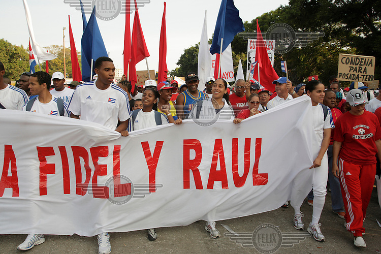 1st of May celebrations. Tens of thousands flock to Plaza de la Revolucion for May Day speeches carrying flags and banners supporting the revolution.
