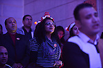 Egyptian Christians take part in a prayer during celebrations of Christmas and New Year festivities, at Kasr el-dobara evangelical Church, in Cairo on December 31, 2014. Photo by Amr Sayed