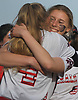 Jessica Budrewicz #9, MacArthur pitcher, hugs twin sister and battery mate Ashley Budrewicz #4 after their team's 2-0 win over Island Trees in Game 2 of the best-of-three Nassau County varsity softball Class A final at Mitchel Athletic Complex on Wednesday, May 24, 2017. MacArthur won the series two games to none.