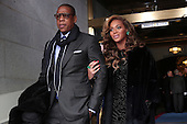 Jay-Z and Beyonce arrive at the presidential inauguration on the West Front of the United States Capitol January 21, 2013 in Washington, DC.   Barack Obama was re-elected for a second term as President of the United States. .Credit: Win McNamee / Pool via CNP