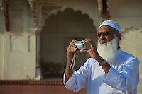 Muslim man and his digital camera Agra India