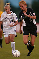 Anita Rapp of the New York Power races downfield pursued by Skylar Little of the Washington Freedom. The Freedom won the game 4-1 which was played on June 29th at Mitchel Athletic Complex, Uniondale, NY.