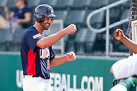 Jordan Danks #15 of the United States World Cup/Pan Am Team is all smiles as he fist bumps his manager Ernie Young after scoring a run against Team Canada at the USA Baseball National Training Center on September 28, 2011 in Cary, North Carolina.  (Brian Westerholt / Four Seam Images)
