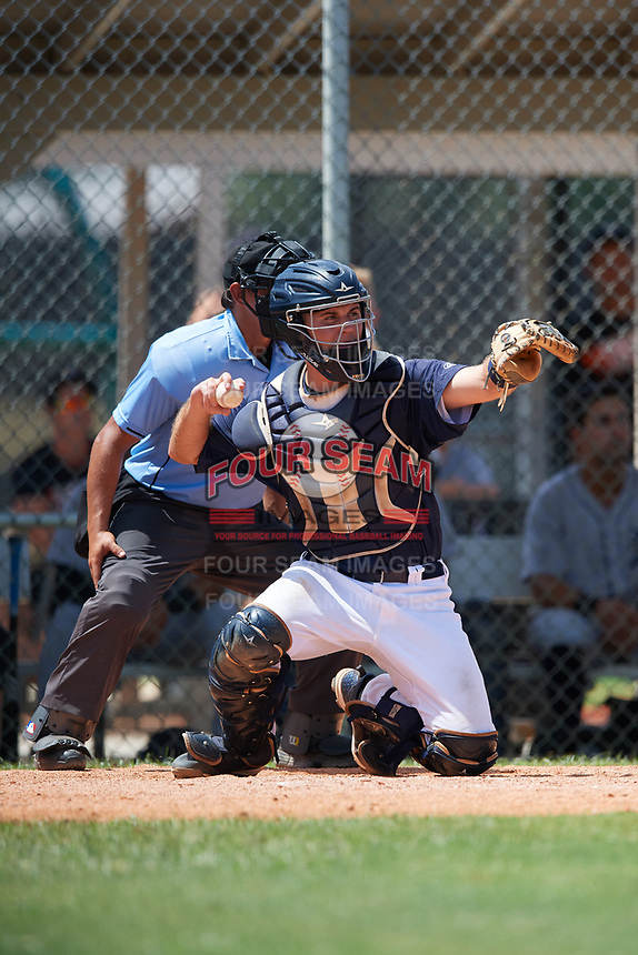 GCL Tigers East catcher David Noworyta (39) prepares to make a throw in front of home plate umpire Mickey Smith during a game against the GCL Tigers West on August 8, 2018 at Tigertown in Lakeland, Florida.  GCL Tigers East defeated GCL Tigers West 3-1.  (Mike Janes/Four Seam Images)