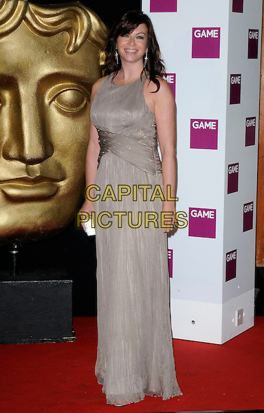 SUZI PERRY .At the British Academy Video Games Awards, London HIlton Hotel, Park Lane, London, England, UK, March 19th 2010..BAFTA full length long maxi sleeveless beige dress taupe brown .CAP/CAN.©Can Nguyen/Capital Pictures