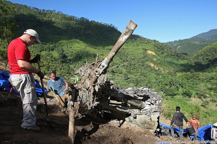 SFC Michael Ospina, left, and SFC Joshua Stone works at a JPAC dig site near Ta Oy, Laos on Wednesday, November 7, 2012. (Star-Telegram/Khampha Bouaphanh)