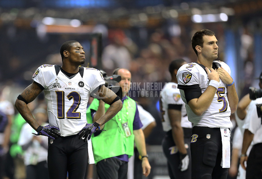 Feb 3, 2013; New Orleans, LA, USA; Baltimore Ravens quarterback Joe Flacco (5) and wide receiver Jacoby Jones (12) during the blackout of the game against the San Francisco 49ers in Super Bowl XLVII at the Mercedes-Benz Superdome. Mandatory Credit: Mark J. Rebilas-