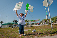 "Calling herself a one-woman army, Andrea Furia, a single mom with four kids from North Port, stood in front of a BP service station along the Tamiami Trail in Port Charlotte, Florida with ""Get Up, Stand Up"" blaring from her boom box, holding balloons and a hand-written sign to show support for the Worldwid BP Boycott, on Saturday, June 12, 2010.  ""I believe that one person can make a difference,"" says Andrea as supporters in passing cars honked and waved, ""and I am doing this today for the future of my children."" Photo by Debi Pittman Wilkey"