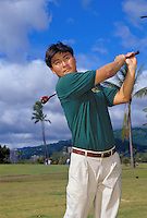 Young Japanese man golfing on Oahu.