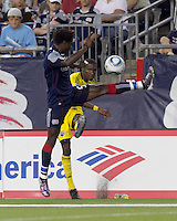 Columbus Crew defender Shaun Francis (29) crosses the ball past Emmanuel Osei. The New England Revolution tied Columbus Crew, 2-2, at Gillette Stadium on September 25, 2010.