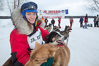 Rose Capistrant poses with her leaders at the finish line of the 2016 Junior Iditarod in Willow, Alaska, AK  February 28, 2016