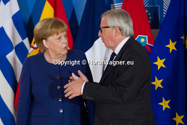 Belgium, Brussels - June 24, 2018 -- Informal working meeting on migration and asylum issues convened by Jean-Claude JUNCKER (ri), President of the European Commission, here welcoming Angela MERKEL (le), Federal Chancellor of Germany -- Photo © HorstWagner.eu