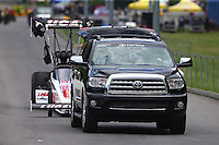 Jun 20, 2015; Bristol, TN, USA; The Toyota tow vehicle towing NHRA top fuel driver Richie Crampton on the return road during qualifying for the Thunder Valley Nationals at Bristol Dragway. Mandatory Credit: Mark J. Rebilas-